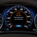 This photo provided by General Motors Co. shows an industry-first Rear Seat Reminder alert on the instrument panel of the 2017 GMC Acadia, a midsize SUV.
