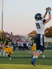 Bay Port's Jack Plumb (89) catches a pass in the end zone to score a touchdown against Ashwaubenon in a Fox River Classic Conference high school football game on Friday, September 8, 2017 at Ashwaubenon high school in Ashwaubenon, Wis.Adam Wesley/USA TODAY NETWORK-Wisconsin