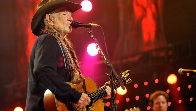 Willie Nelson performs during the Farm Aid 2013 concert at Saratoga Performing Arts Center in Saratoga Springs, N.Y., Saturday, Sept. 21, 2013.