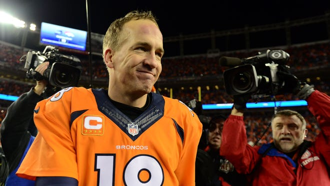 Denver Broncos quarterback Peyton Manning (18) leaves the field following the   in a AFC Divisional round playoff game at Sports Authority Field at Mile High.