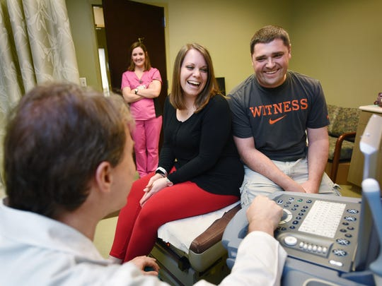 In this 2016 photo, Trisha and Brett Gibson share a laugh with Dr. Preston Parry, left, while reviewing Trisha's sonogram at the University of Mississippi Medical Center's Women's Specialty Clinic in Flowood.
