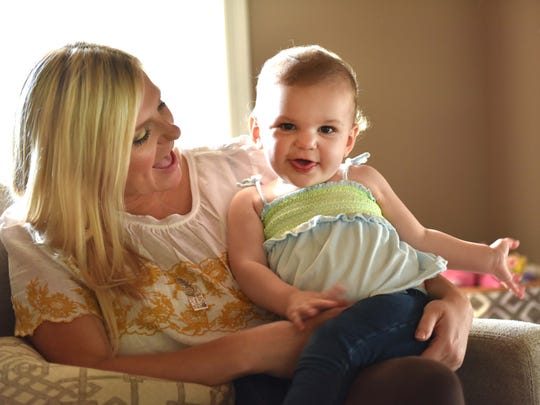 Lauren Bowie and daughter Emerson play in their home in Madison. Lauren and husband Walt lost their infant son, Wills, to Trisomy 18 in 2013. They brought Emerson home in August 2015. She weighed 8 pounds, 10 ounces, or precisely twice as much as Wills.