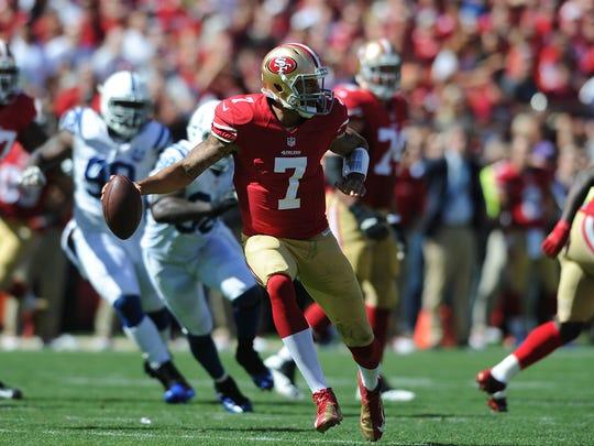 49ers quarterback Colin Kaepernick (7) scrambles during the second quarter. Indianapolis Colts play the San Francisco 49ers.
