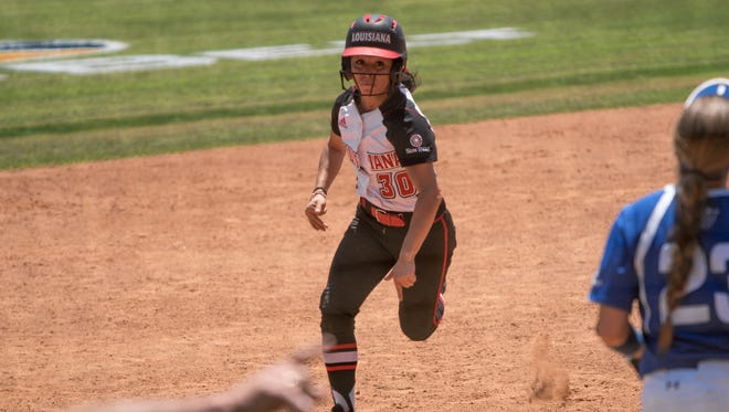 UL's Kelli Martinez is sent home with the winning run in the Ragin' Cajuns' 2-1 opening Sun Belt Conference Tournament win over Georgia State on Thursday.