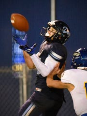Becker's Lucas Dertinger comes down with a pass over
