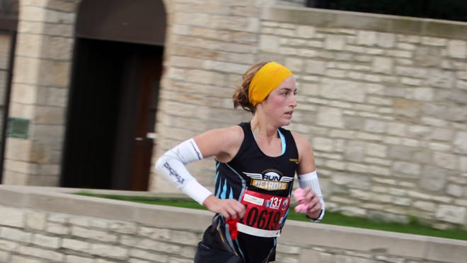 Sarah Gryniewicz, 25, of Grosse Pointe Woods just comes out of the tunnel back to Detroit during the 37th Annual Detroit Free Press/Talmer Bank Marathon in Detroit on Oct. 19.