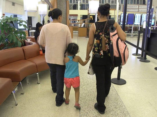 (L to R) Rosa walks with her sister Maria while holding her niece's hand at the Louis Armstrong New Orleans International Airport in Kenner, Louisiana on Friday, June 29, 2018. Rosa who came to the United States from Honduras seeking asylum in May 2018 with her son Juan, was detained and separated from him. She was recently released from being held in Denver and made her way to New Orleans to be reunited with Maria who she hasn't seen since January of 2016.