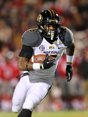 Missouri running back Marcus Murphy picks up a yards during the Tigers' victory at Ole Miss.