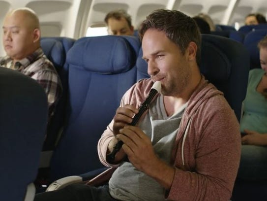 Screengrab from Doritos' ad, Middle Seat.