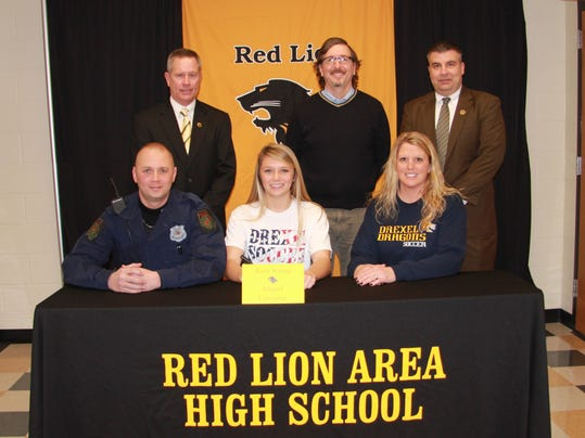 Pictured, from left, front row: Robert Strong Jr., Kylie Strong and Lisa Strong. Back row, from left: athletic director Arnie Fritzius, coach Matt Zimmerman and principal Mark Shue. (SUBMITTED)
