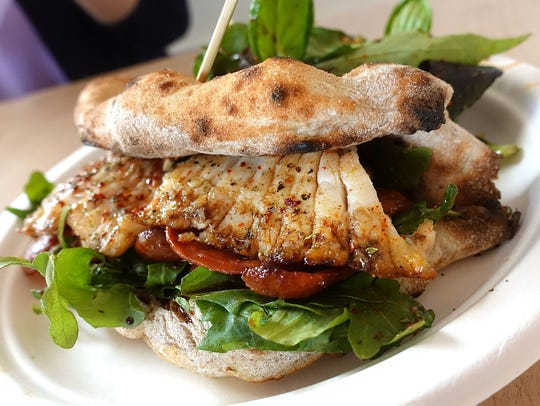 """Pita"" sandwich made with schiacciata, roasted skate"