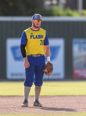 Henderson Flash third baseman Paul Haupt (20) stands near third base during the first doubleheader match against the Fulton Railroaders at B.T. Wayne Field in Henderson, Ky., Tuesday, June 19, 2018. The Flash defeated the Railroaders in the doubleheader games, 8-7 and 10-9, to continue their six game winning streak.