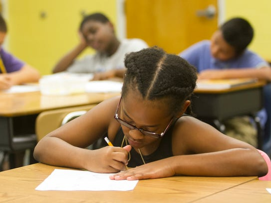 Jurni Vincent works on a math problem on Tuesday at