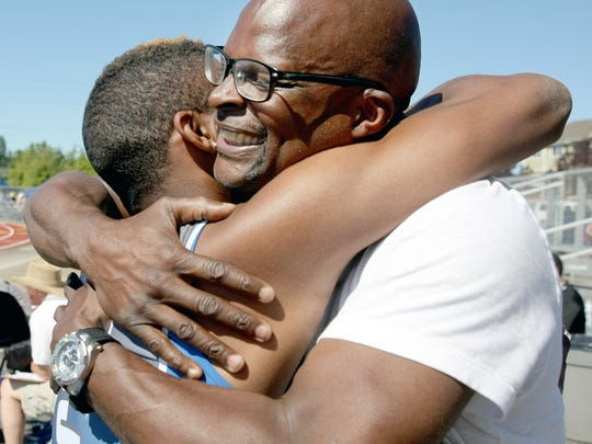 Olympic's Darelle White hugs his grandfather, Darrell