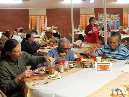Local community members enjoy Thanksgiving dinner together at Our Savior Lutheran Church on Thursday.