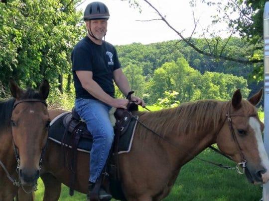 David Kettering, 58, of Stewartstown, rides a horse