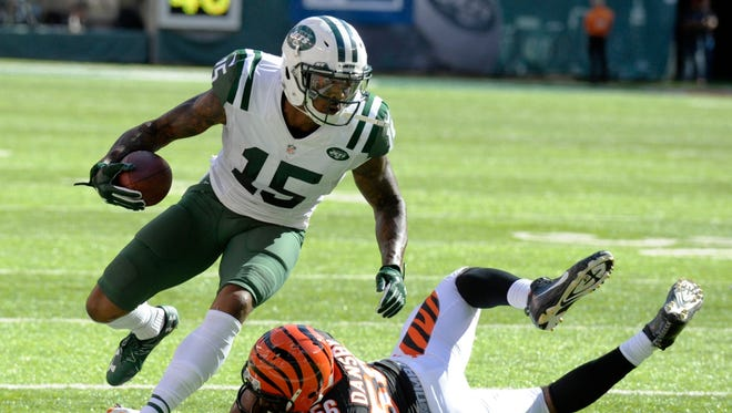 New York Jets wide receiver Brandon Marshall (15) runs past Cincinnati Bengals' Karlos Dansby (56) during the second half of an NFL football game Sunday, Sept. 11, 2016 in East Rutherford, N.J.