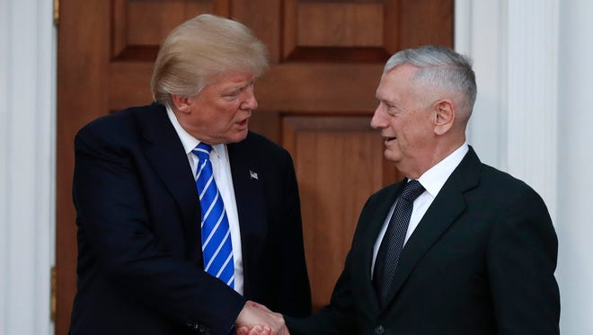 In this Nov. 19, 2016, file photo, President-elect Donald Trump shakes hands with retired Marine general James Mattis as he leaves Trump National Golf Club Bedminster clubhouse in Bedminster, N.J.