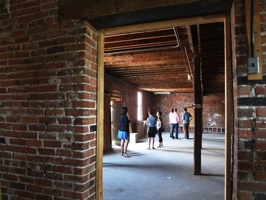 Attendees tour the former Northern Colorado Feeders