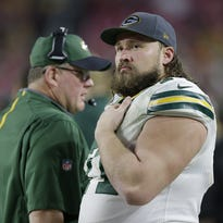 Green Bay Packers guard Josh Sitton looks on from the sideline in the fourth quarter against the Arizona Cardinals.