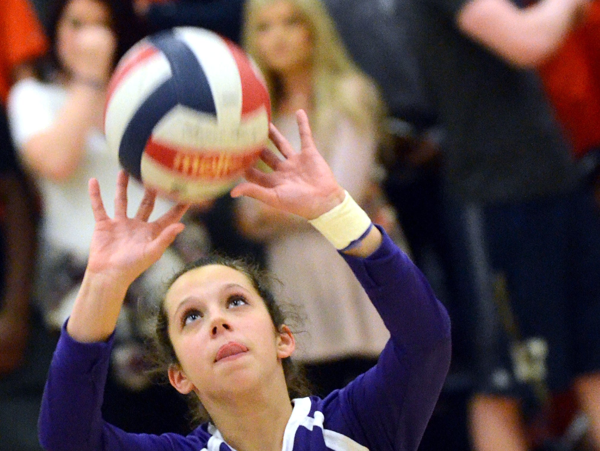 Portland High sophomore Rachel Jennings sets a pass during the second game of Tuesday evening's championship match.