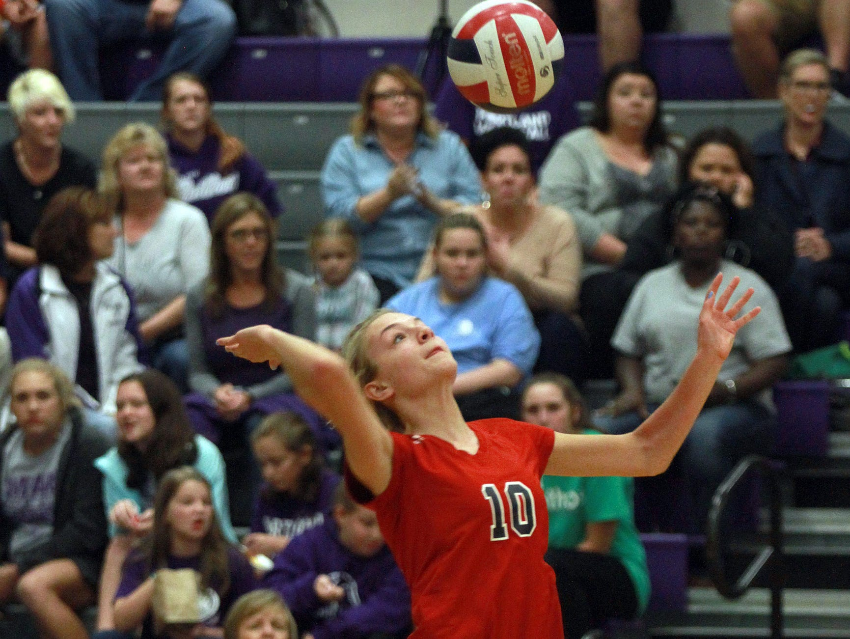 Ravenwood's Victoria Cerino serves against Portland during Thursday's Class AAA sectional match.