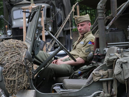 John Rooster sits in a jeep in the U.S. Army WWII expo