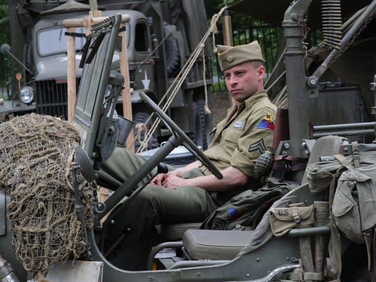 John Rooster sits in a jeep in the U.S. Army WWII expo area.