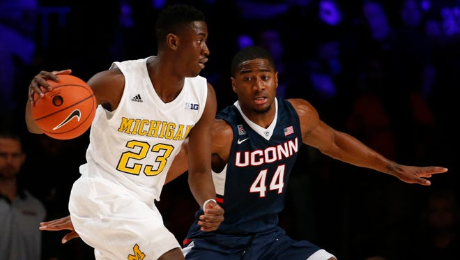 Nov 25, 2015; Paradise Island, BAHAMAS; Michigan Wolverines guard Caris LeVert (23) dribbles as Connecticut Huskies guard Rodney Purvis (44) defends in the first half during the 2015 Battle 4 Atlantis in the Imperial Arena at the Atlantis Resort..