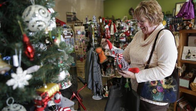 Linda Dittburner, of Oshkosh, looks at Christmas items while browsing at Cedar Ridge Crafts & Gifts n Neenah.