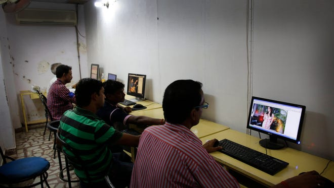 Indian youth use the Internet at a cyber cafe in Allahabad, India, on Aug. 3, 2015. India had ordered Internet service providers to block access to more than 850 adult websites in what the government has described as a way to protect social decency.
