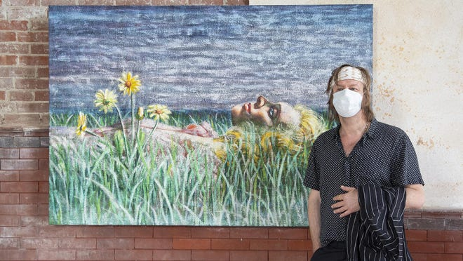 Artist Piotr Uklanski on Tuesday stands next to one of the works to be exhibited inside Belmont Chapel starting Friday.