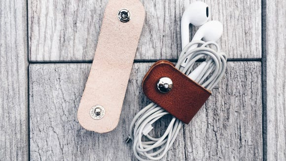 These smart leather cable organizer are a great stocking stuffer, wrapping around your headphones so they don't get tangled.