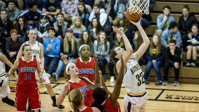 Port Huron Northern senior Bree Bauer makes a shot on a host of Cousino defenders during a basketball game Wednesday, Jan, 4, 2017 at Port Huron Northern High School.
