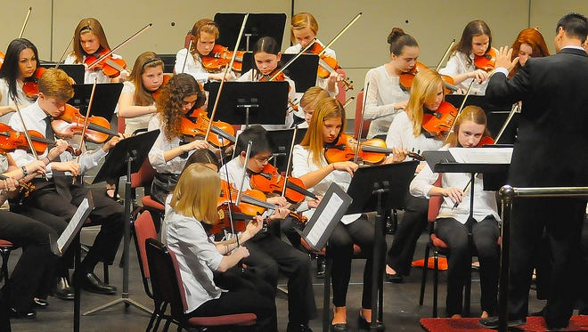 Members of the Mansfield Symphony Youth Strings perform in 2014.