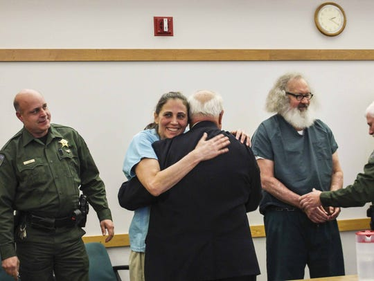 Evi Quaid hugs attorney Peter Langrock after a judge