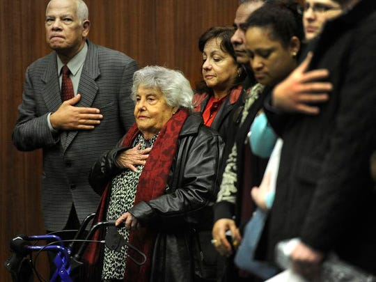Zoila Mojica, 93, says the Pledge of Allegiance and