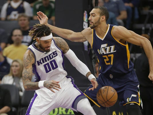 Sacramento Kings center Willie Cauley-Stein, left, reaches for a loose ball against Utah Jazz center Rudy Gobert during the first half of an NBA basketball game Wednesday, March 29, 2017, in Sacramento, Calif. (AP Photo/Rich Pedroncelli)