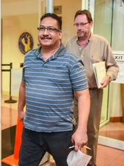 In this August 2017 file photo former police officer Mark Charfauros, front, exits the Judiciary of Guam Northern Court Satellite with his attorney, F. Randall Cunliffe, after his arraignment.