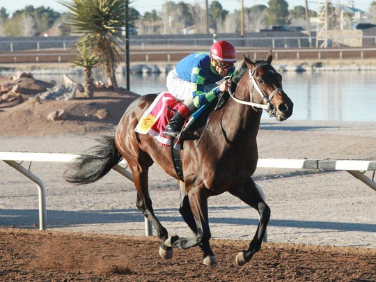 Runaway Ghost runs at the Sunland Park Racetrack and Casino along with jockey Tracy J. Hebert.
