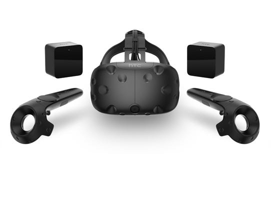 HTC Vive headset, controllers and Lighthouse base stations.