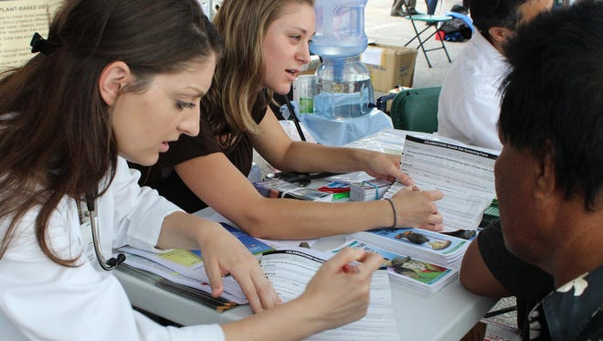 The Northern Seventh Day Adventist Church, the SDA Clinic, and Guam Adventist Academy's Medical Club students held a health outreach at the Dededo flea market on April 6, 2014.