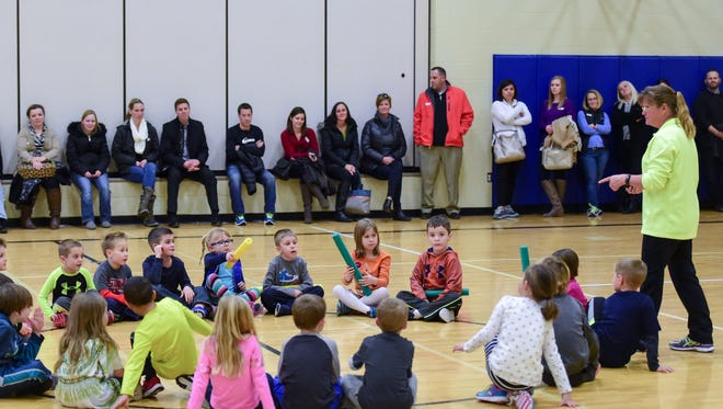 Physical Education Teacher Jodi Schutt talks with the kindergarteners and parents on Thursday, January 21, 2016, during Kindergarten Parent Day at Webster Elementary School.