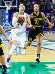 FGCU's Whitney Knight drives on Bethune-Cookman's Lyndsey Edwards. The FGCU women's basketball team played Bethune-Cookman, in their first round game in the Women's NIT. The game was played in Alico Arena, Fort Myers, Florida, Friday, March 18, 2016.