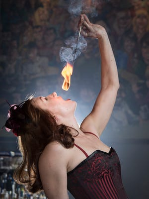 Sadie Blaze (Jama Jenkins) practices her fire-eating routine at Cabaret in Pensacola on Tuesday, January 31, 2017.