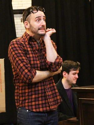 "Joe Kinosian (left) rehearses a scene from ""Murder for Two."" Co-star Matt Edmonds is at the piano."