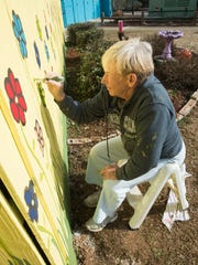 Volunteer Donna Underdork, helps to spruce up the Escambia