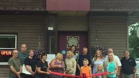 Mishicot business owners, residents and members of MAGIC celebrate the grand re-opening of Cozy Corner Cafe.