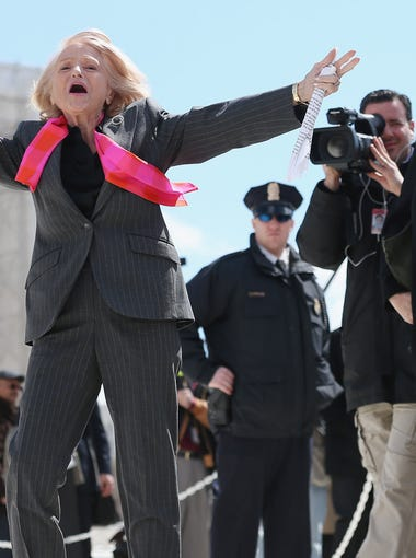 Edith Windsor acknowledges her supporters as she leaves the Supreme Court March 27, 2013 in Washington, DC. The Supreme Court heard oral arguments in the case 'Edith Schlain Windsor, in Her Capacity as Executor of the Estate of Thea Clara Spyer, Petitioner v. United States,' which challenges the constitutionality of the Defense of Marriage Act (DOMA), the second case about same-sex marriage this week.