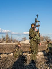 Members of the Azov Brigade participate in weapons